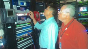 Senior Engineers Murray Clawson and Micky Chan in front of KTLA'smain and backup AERO.air Transmission Audio Loudness Managers.  A Linear Acoustic LAMBDA Digital Audio and Metadata Monitor is used to measure and monitor the station's audio.