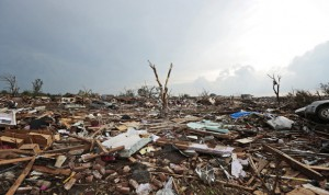 Debris covers the ground after a powerful tornado ripped through the area on May 20, 2013 in Moore, Oklahoma. The tornado, reported to be at least EF4 strength and two miles wide, touched down in the Oklahoma City area on Monday killing at least 51 people. (Photo by Brett Deering/Getty Images)