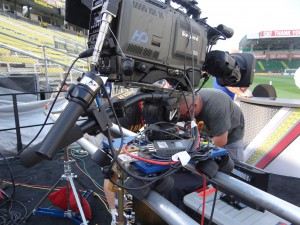 "ESPN's on-field game studio is covered by three Ikegami 79EC cameras, including this one which is mounted to a tracking device that utilizes metal piping and skateboard wheels. The crew is calling it the ""MunDolly."""