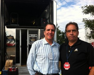 NBC's Fred Gaudelli and Tim Dekime outside the Featherlight office trailer in the Mile High parking lot