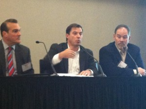 ScheduALL's Rob Evans (center) speaks as LTN's Matt Coppola (left) and Masergy's Dan Boland look on.