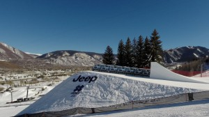 A 3D model of a line of Jeep Wranglers overlaid on top of an image of the SlopeStyle course