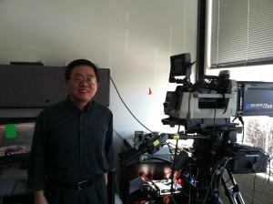 Ximin Gong stands with an instrumented camera, on which he experiments with different graphics tools and algorithms.