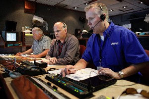 ESPN's NHRA producer Eric Swaringen (right) and director Bruce Watson (center) with the NHRA technical director (Photo courtesy ESPN Image)