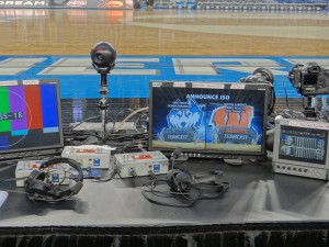 The NCAA reserved six additional slots of press row for the Teamcast annoucers. To give their local talent time on cameras, the production crews are using QBall robotics.
