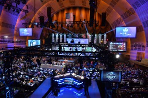 At this year's NFL Draft, fans were seated closer to the stage than ever before, with team tables set up behind the fans and in front of network sets. (Photo by Rich Arden / ESPN Images)