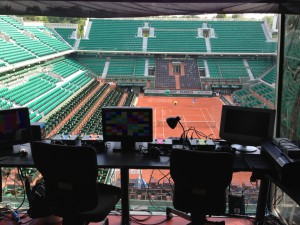 ESPN and NBC share an announce booth at Roland Garros's Court Philippe-Chatrier.