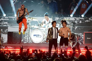 Bruno Mars says a Super Bowl performance is something you don't say no to. But is it something the artist should pay for?
