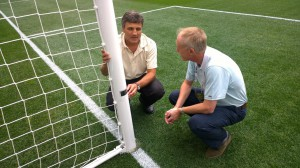 ESPN director Bob Frattaroli (left) and General Manager, Professional Referees Organization Peter Walton inspect the goal posts during a trial of the system last month at Red Bull Arena.