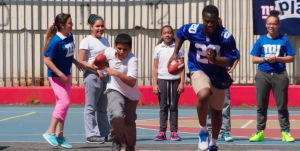 WATCH: Prince Amukamara shows off his hula-hoop skills, learns some football fundamentals.