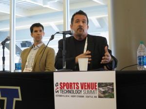 Cisco Sports and Entertainment's Ed Olsen (right) speaks as Pac-12 Networks' Ryan Currier looks on.