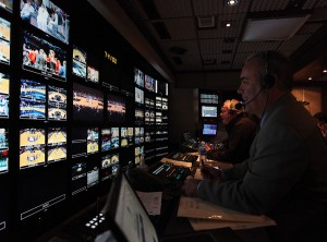Producer Frank DiGraci (foreground) and director John Wilson at the front bench inside Game Creek Video's Dynasty. (Photo: Ellen Wallop/YES Network)