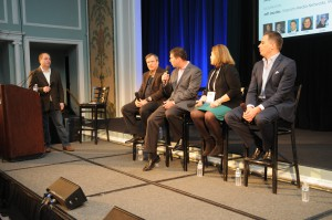 Jeff Jacobs of Viacom Networks (at podium) moderated a discussion that featured (l-to-r) Don Colantonio of ESPN; Ed Delaney of Fox Sports; Susan Stone of MLB Network; and Pete Radovich of CBS Sports.