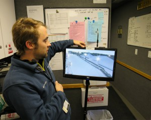 BSI's Eric Pfeiffer shows off one of the company's digital return-video system monitors for on-air talent.