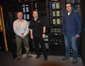Brian Learoyd, Engineering Manager at Rogers Sportsnet, John Christie, Wireless and Broadcast Specialist at RP Dynamics, and Tim Hicks, Broadcast Engineer at Rogers Sportsnet show off their new equipment room.