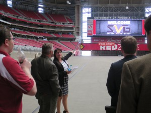Arizona Cardinals' Amanda Flanagan leads attendees on a tour of the venue.
