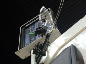 Klover Products' 9-in. parabolic dish, used to capture court effects, is attached about 5 ft. behind the glass backboard and aimed down and towards the court.