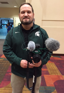 Jacob Huber, Video Producer for Spartan Vision, shot footage during a team pep rally on Friday night in the Indiana Convention Center.