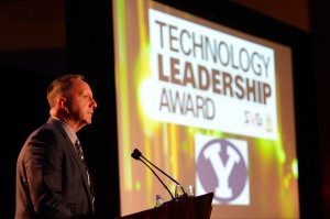 BYUtv's Mikel Minor accepts the SVG/NACDA Technology Leadership Award on behalf of Brigham Young University on Thursday.
