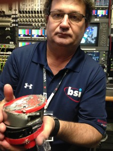 BSI EIC Doug Parr holds one of the in-car cameras damaged during practice runs.