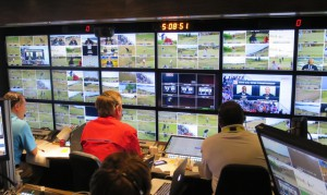 Mark Loomis, coordinating producer for Fox Sports (left) and Steve Beim, director, calling the shots inside Game Creek Video's Encore unit.