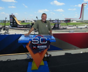 Illumination Dynamics' Rich Williams on the X Games set atop the COTA paddock building