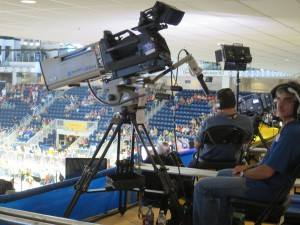 A Sony camera with Canon lens captures gymnastics from the top of the Toronto Coliseum.