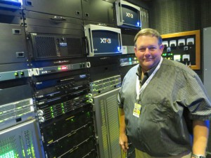 Paul Bonar of Game Creek Video inside the PeacockOne engine room, featuring two Evertz routers and up to 24 EVS XT[3] servers.