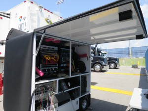 The tech cart that will be used to transport audio and video signals from the mobile studio set back to the compound.