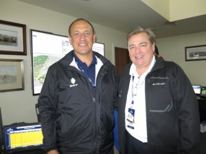 Rallis Pappas and Gerard Hall of SMT inside SMT's operations area at The Open in St. Andrews.