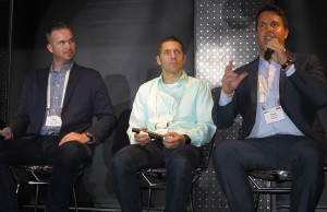 NeuLion's Dave Alloway (right) describes the perfect candidate for OTT as the AAC's Mark Hodgkin (far left) and Golding Media Ventures' Frank Golding look on.
