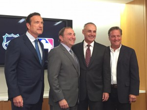 The NHL's John Collins and Gary Bettman with MLB's Rob Manfred and Bob Bowman at the official announcement of the partnership at the NHL's offices in New York City.