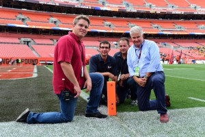Jed Drake (right) and crew with pylon camera during a preseason NFL game. (Photo by Phil Ellsworth / ESPN Images)