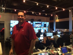 EVP Bob Becker stands in VWSE Productions' control room, located in Arthur Ashe Stadium.