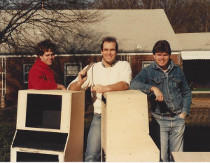 From left to right, Andre Ancelin, Dave Cook, and Ron Johnson stand with an early build of the ACTIVE Broadcasting System circa 1986.